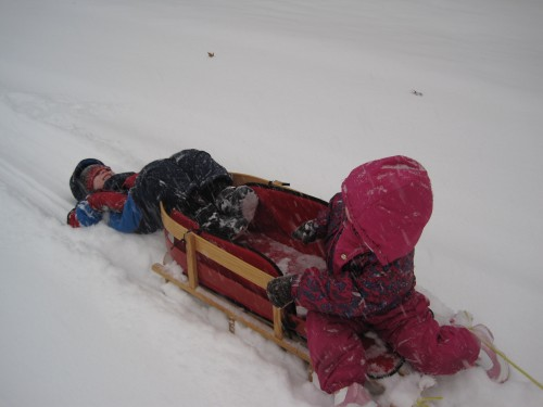 This is a silly way to sled (and tough for the mommy doing the pulling!)