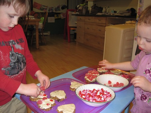 Kids decorating cookies