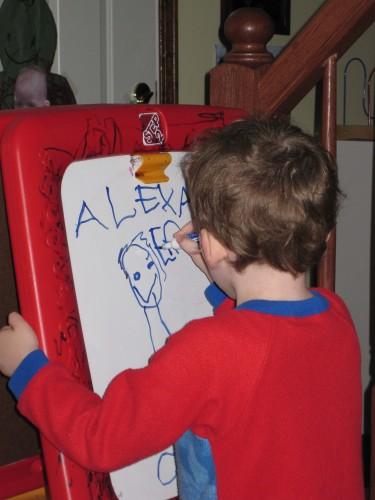 Lex writing his name