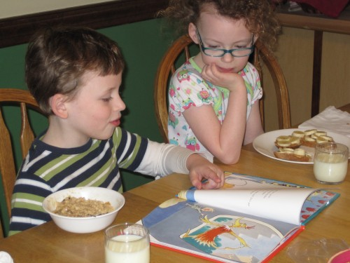Because it was her birthday, Lex agreed to read her new book out loud at breakfast.  She loves when Lex reads to her.
