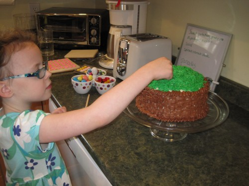 Eve helped me put the finishing touches on her birthday cake.