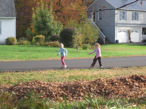 Then they spent some time pretending to walk past the house to see how it looked.  They varied their walking styles and speeds, in case that made a difference in the appearance of the leaf man.  :)