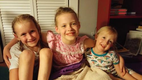 Sweet girls cuddling before bedtime.